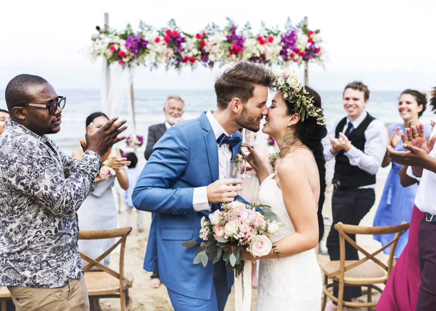 Young Couple Kissing At Wedding Reception